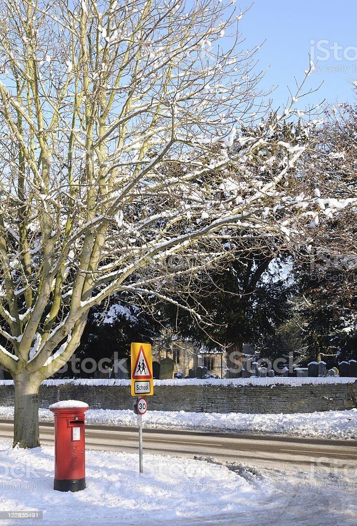 Village Post Box, Fladbury, under Snow royalty-free stock photo
