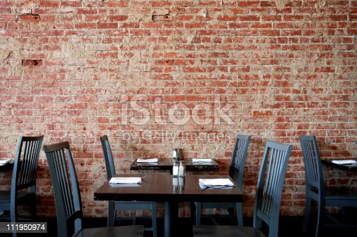 istock Village Pub Brick Wall with Tables and Chairs 111950974