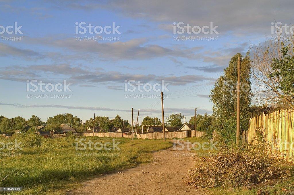 Деревенская дорога на закате стоковое фото