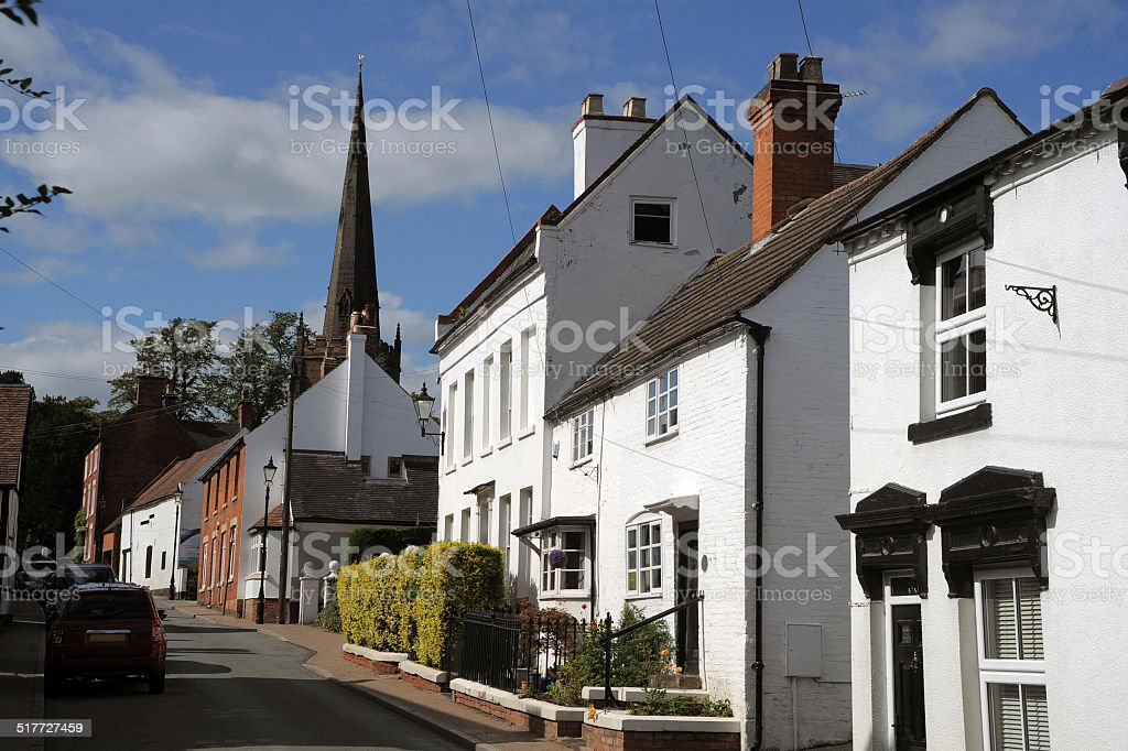 Village Street and Church stock photo