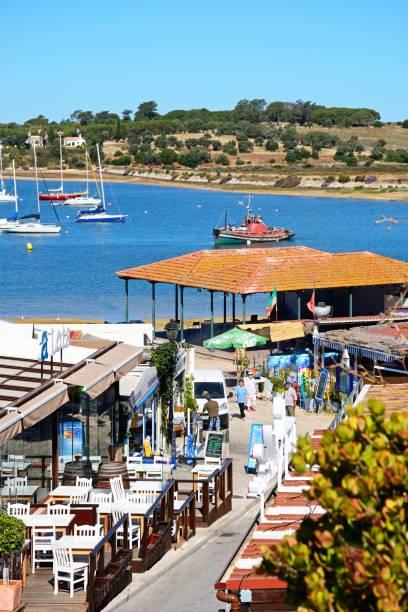 village street and estuary, alvor. - esplanada portugal imagens e fotografias de stock