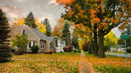 pretty village street in autumn