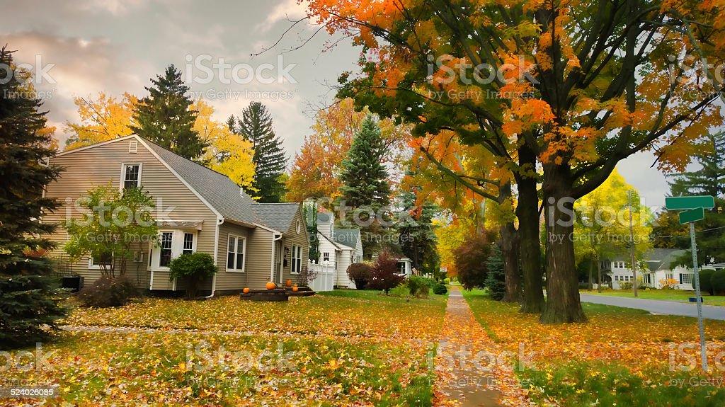 village street in autumn stock photo