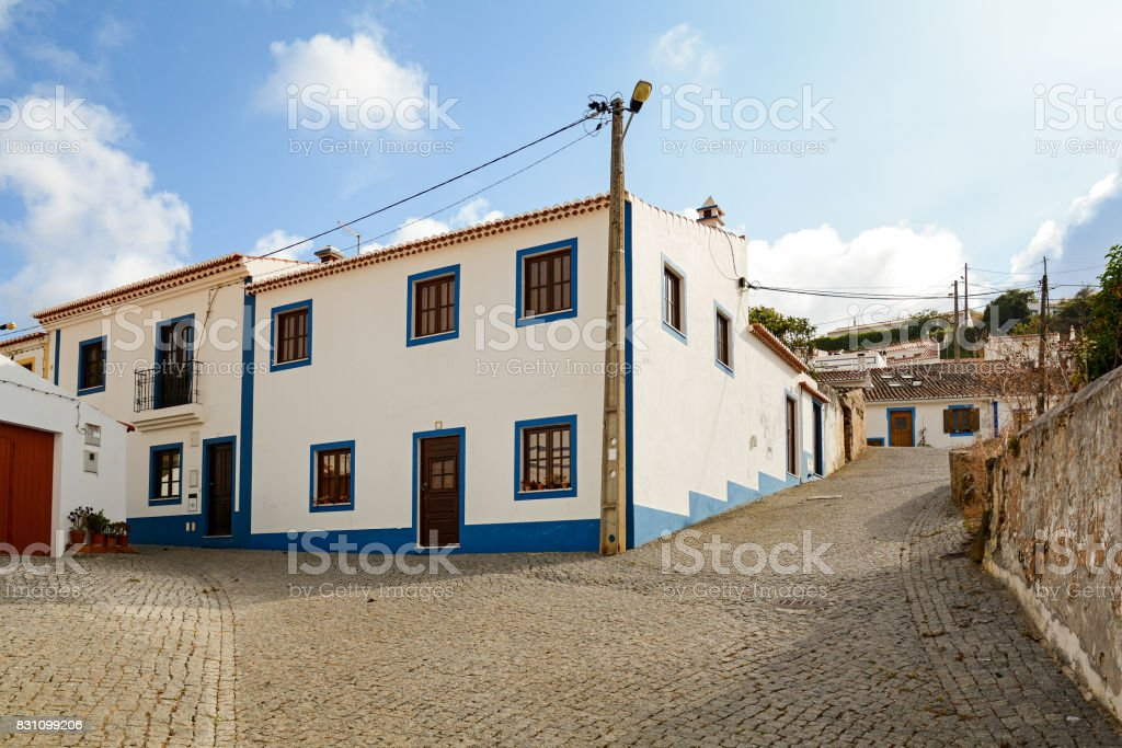 Village street with residential buildings in the town of Bordeira near Carrapateira, in the municipality of Aljezur in the District of Faro, Algarve Portugal stock photo