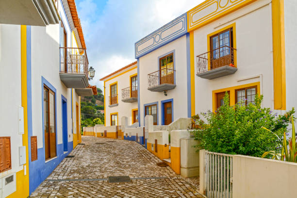 village street with residential buildings in the town of bordeira near carrapateira, municipality of aljezur, district of faro, algarve portugal - portugal stock photos and pictures