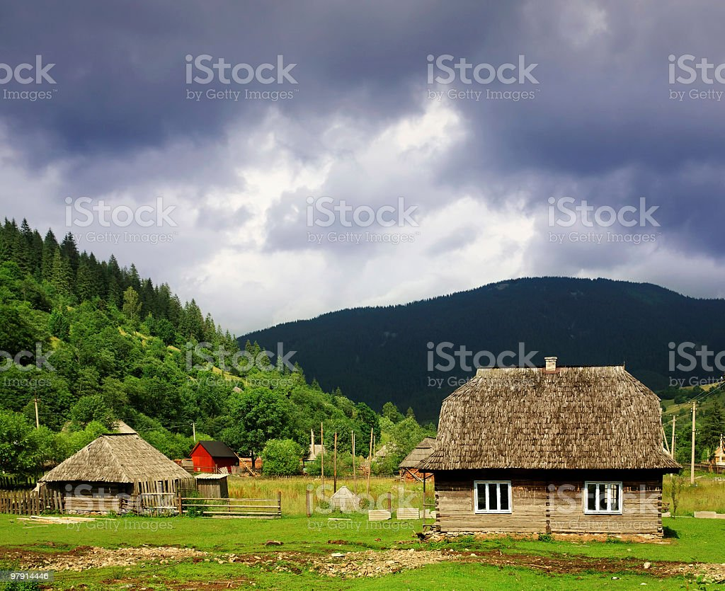village under heavy clouds royalty-free stock photo