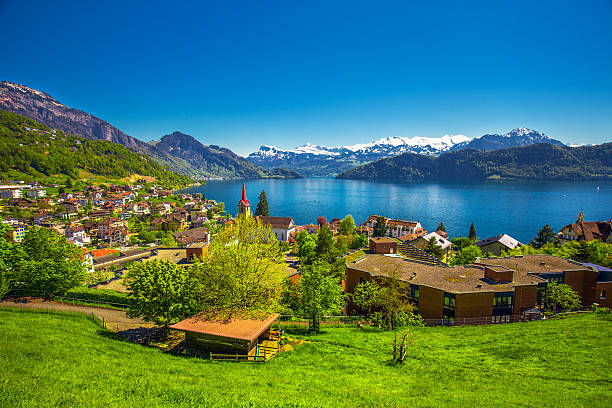 Village Weggis, lake Lucerne and Pilatus mountain from Weggis Village Weggis, lake Lucerne (Vierwaldstattersee), Pilatus mountain and Swiss Alps in the background near famous Lucerne city, Switzerland switzerland stock pictures, royalty-free photos & images