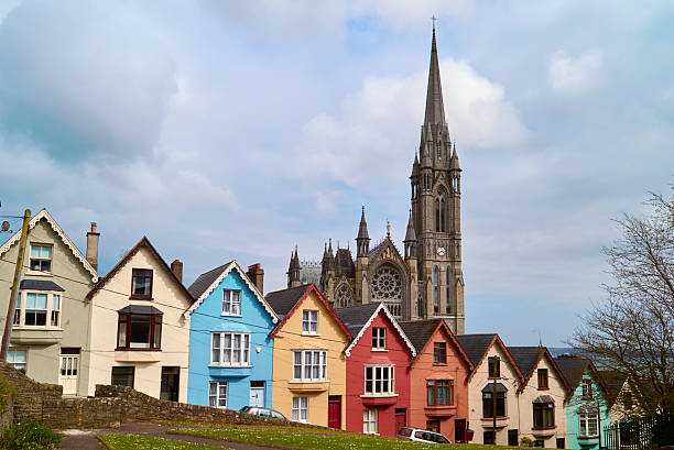 village with cathedral and colored houses stock photo