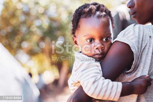 Africa, Village Life, Baby, Mother - An African Village Woman with her baby in the village