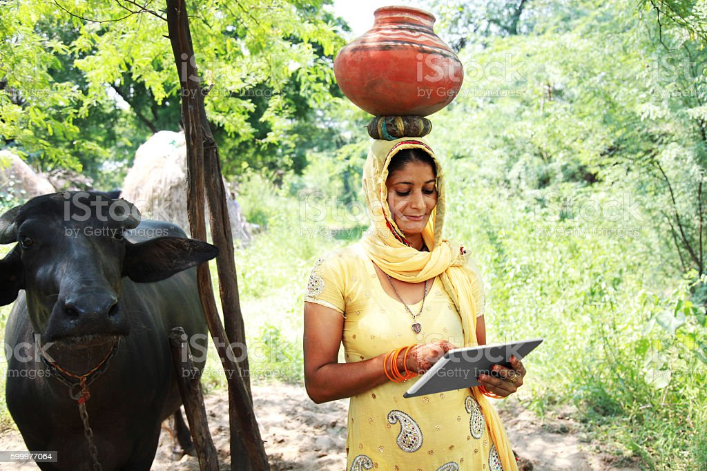 Village women using digital tablet stock photo