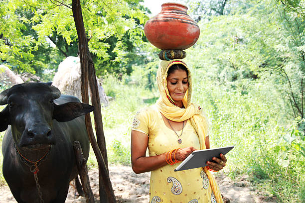 village women using digital tablet - village stock photos and pictures