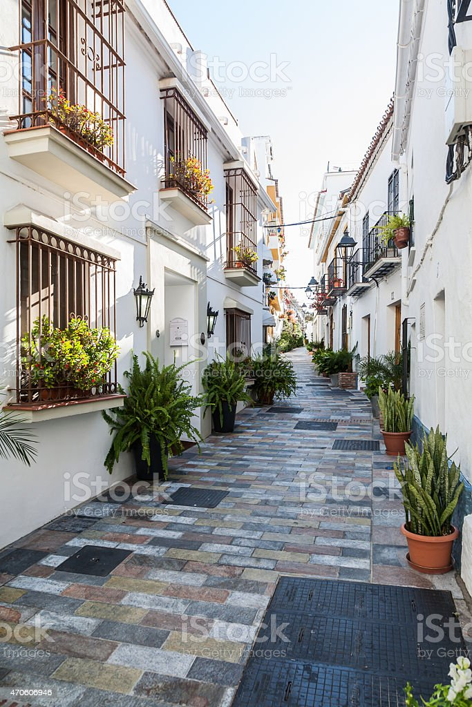 Villages of Andalucia with flowers in the streets stock photo