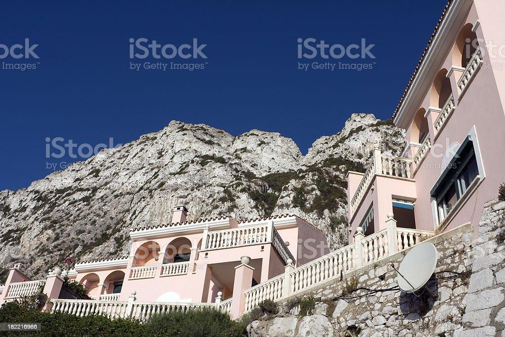 Villas beneath a mountain royalty-free stock photo
