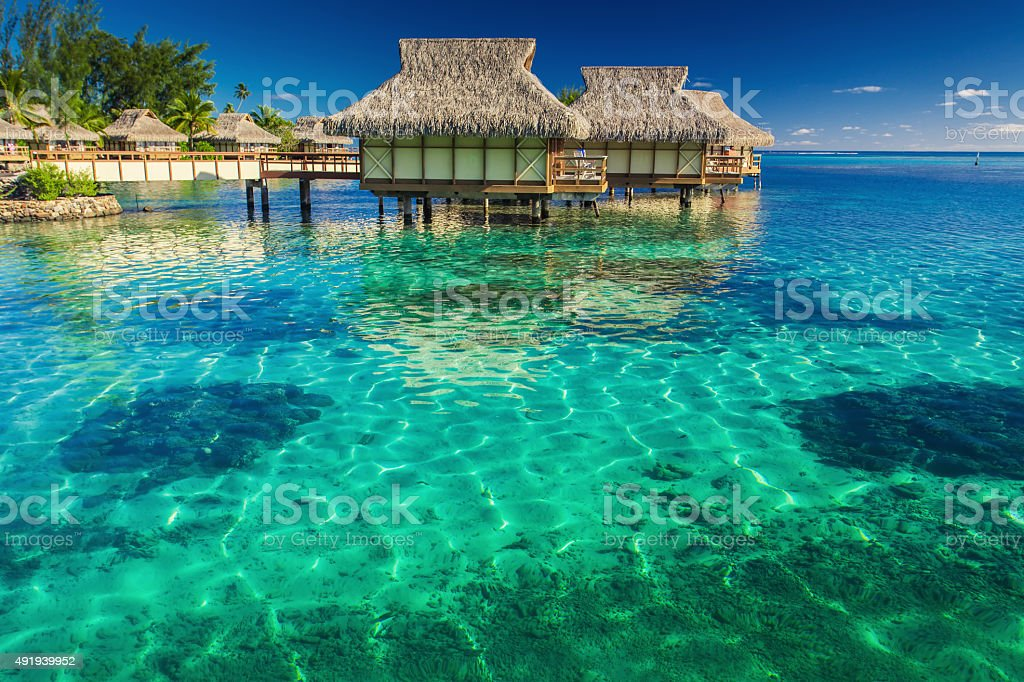 Villas in the lagoon with steps into shallow water stock photo
