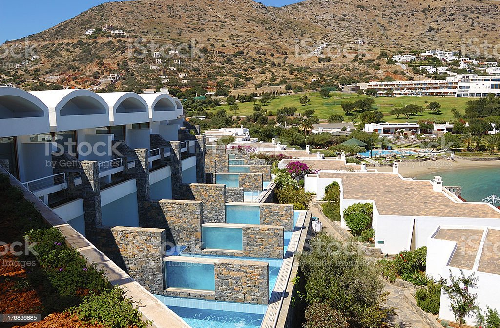 Villas with swimming pools of luxury hotel, Crete, Greece royalty-free stock photo