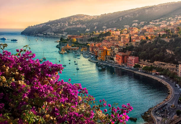 Villefranche sur Mer in evening Coastline on the French Riviera with the small village : Villefranche Sur Mer provence alpes cote d'azur stock pictures, royalty-free photos & images