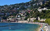 Villefranche Sur Mer, Nice - August 4 2019: people on beach and bay view