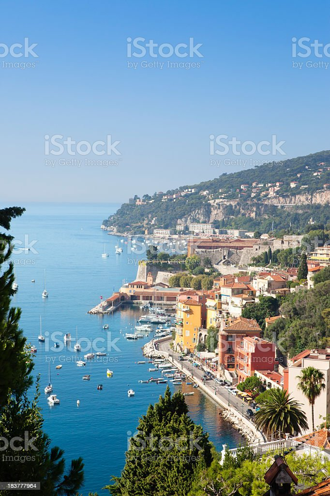 Villefranche-sur-Mer filled with boats off the shoreline royalty-free stock photo