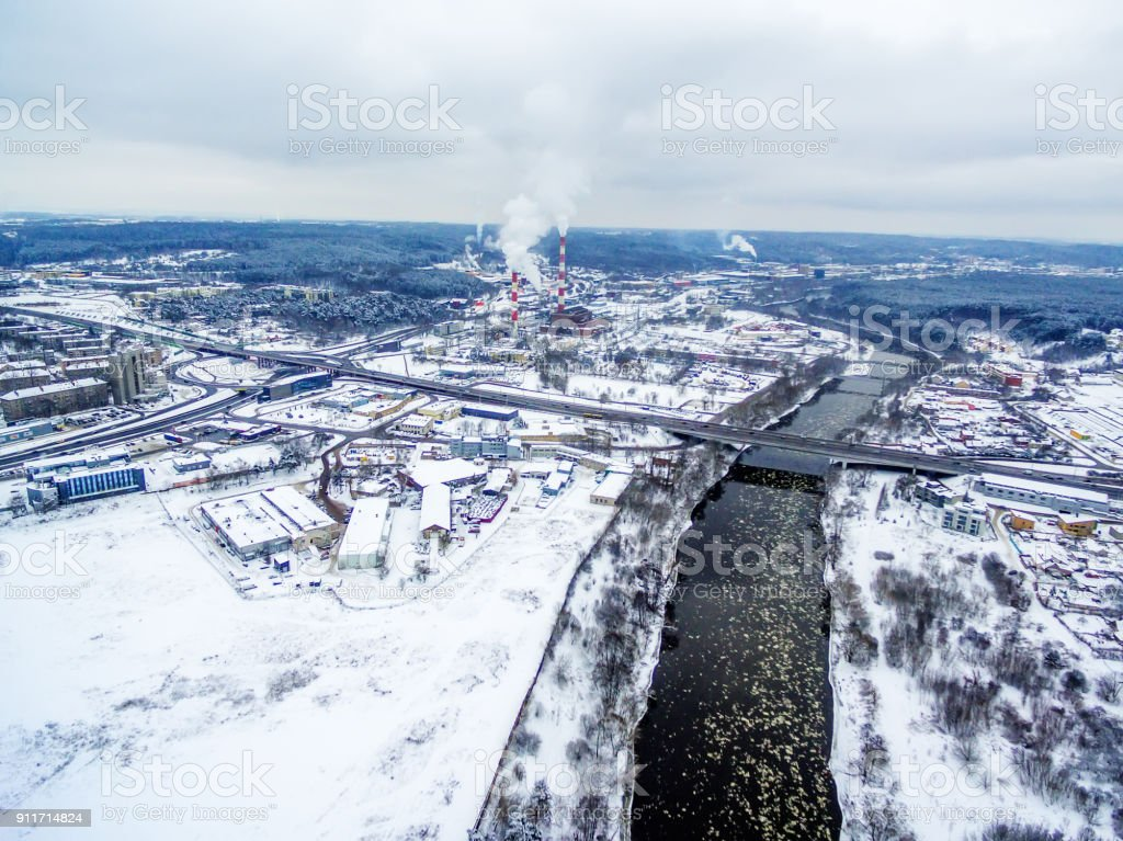 Vilnius, Lithuania: aerial top view of Neris river and Lazdynai Bridge in winter stock photo