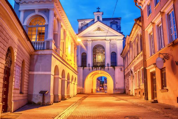 Vilnius, Lithuania: the Gate of Dawn, Lithuanian Ausros, Medininku vartai, Polish Ostra Brama  in the sunrise stock photo