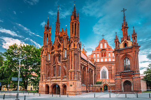 Vilnius, Lithuania. View Of Roman Catholic Church Of St. Anne And Church Of St. Francis And St. Bernard In Old Town In Summer Sunny Day. UNESCO World Heritage