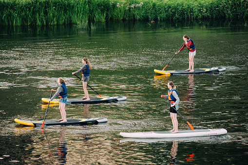 Vilnius, Lithuania. Young People Stand Up Paddling SUP Or Standu