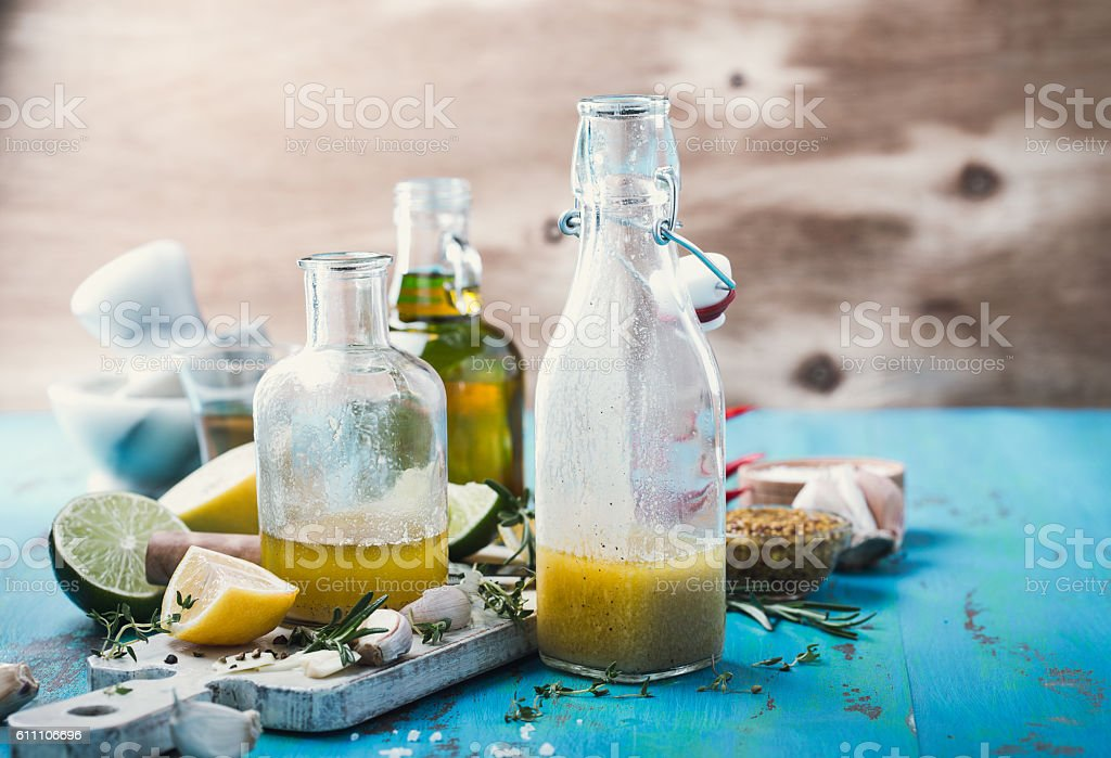 Vinaigrette and ingredients, salad dressing with oil, vinegar and mustard stock photo