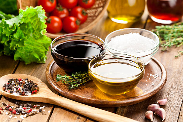 Vinaigrette ingredients on rustic wood table stock photo