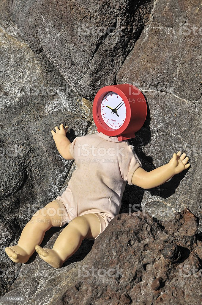 Vinatage Ancient Doll with Clock Face royalty-free stock photo