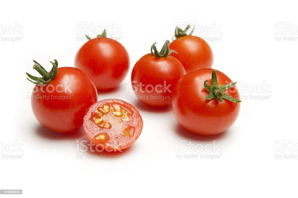 Vine Ripe Cherry Tomatoes with Sliced Half stock photo