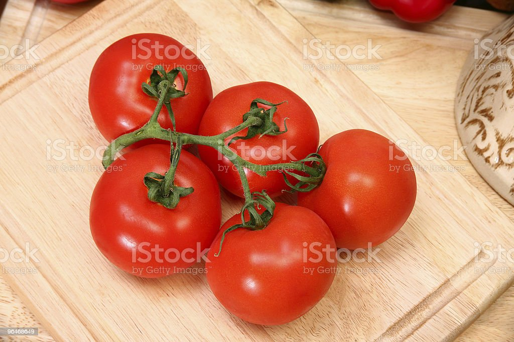 Vine Ripe Tomatoes on Cutting Board royalty-free stock photo