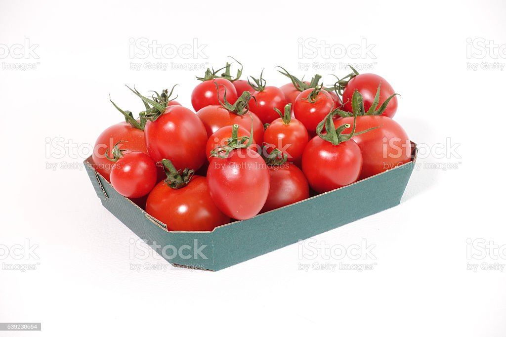 Vine tomatoes in green tray royalty-free stock photo