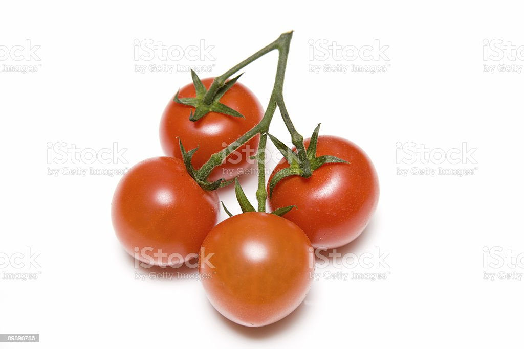 Vine tomatoes isolated on a white background. royalty-free stock photo