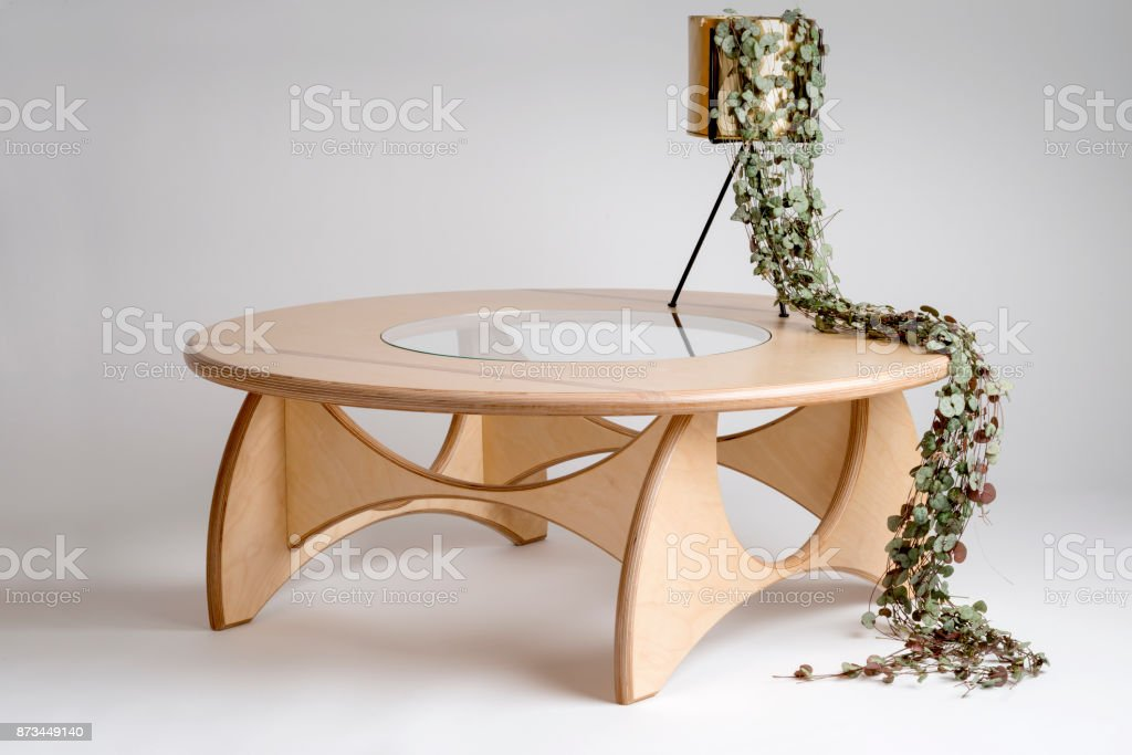 Vines in Shape of a Person Sitting on Wooden Round Table stock photo