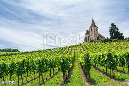 istock vineyard and medieval church in Alsace, France 941110924