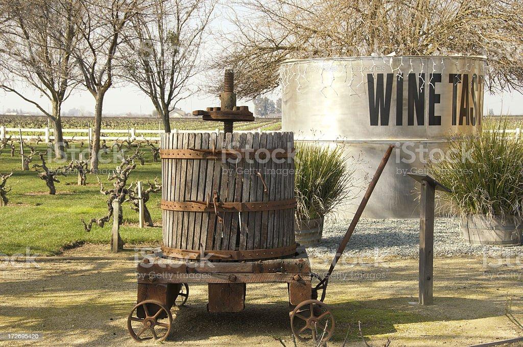 vineyard with antique wine press stock photo