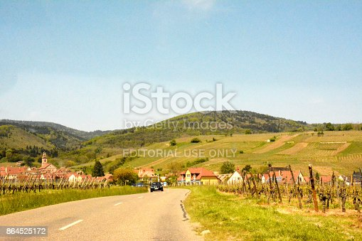925850210istockphoto vineyards and road with car in Alsace France 864525172