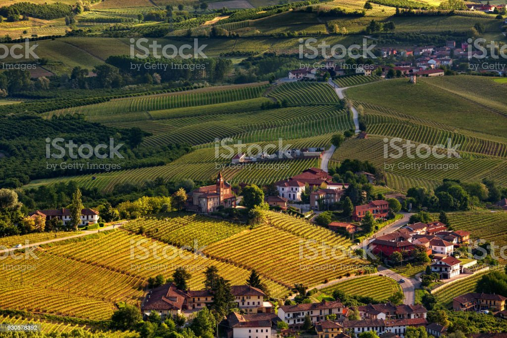 Vineyards and small town in Piedmont, Italy as seen from above. stock photo