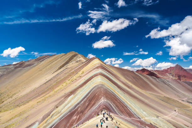 Vinicunca Rainbow Mountain is located between Cusco and Puno in Peru. stock photo