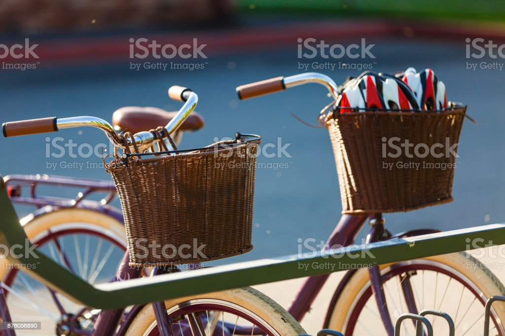 Vintag  bicycle with basket parked on the street retro wallpaper background shallow focus stock photo