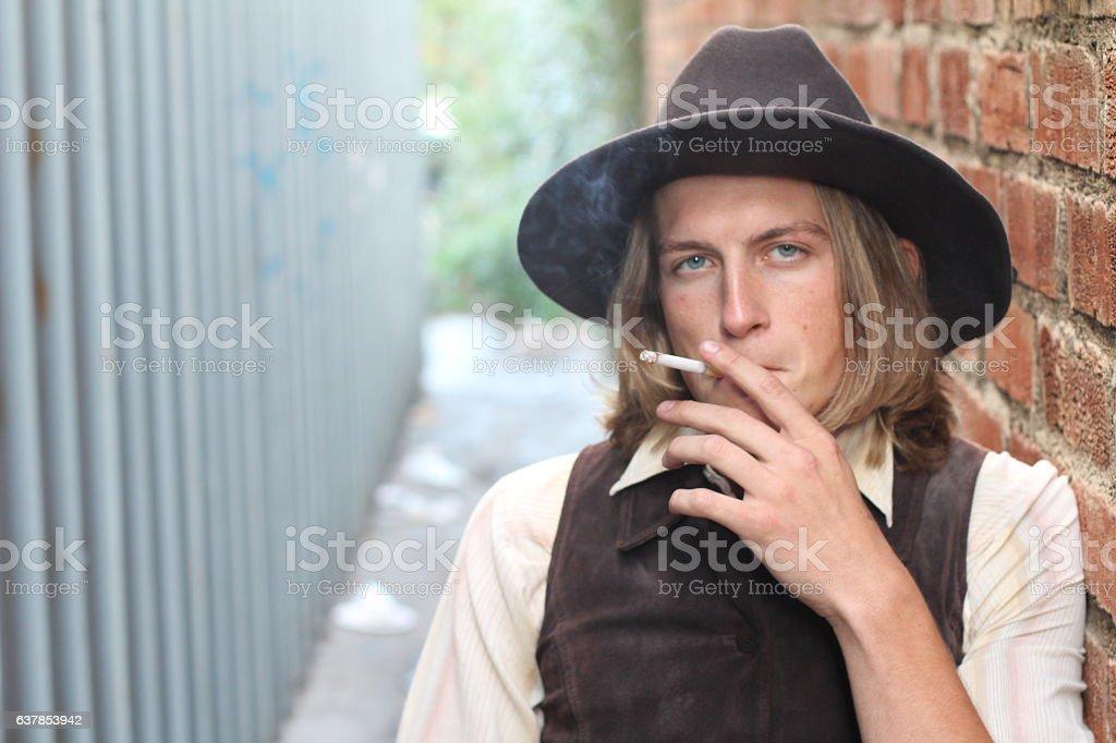 Vintage 1900 cowboy smoking stock photo