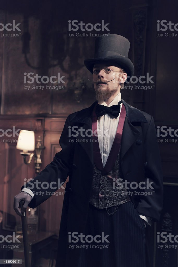 Vintage 1900 fashion man with beard and black hat. stock photo