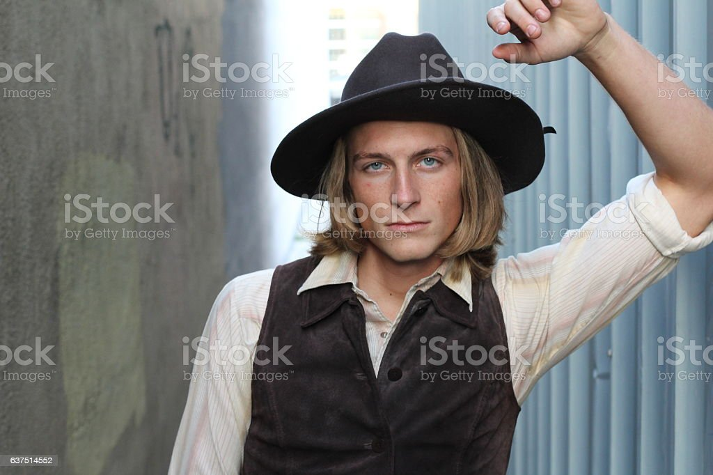 Vintage 1900 young cowboy stock photo