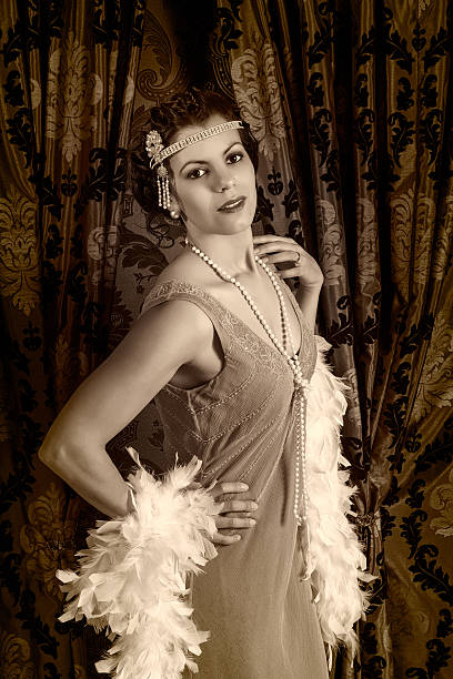 Vintage 1920s woman with boa Beautiful vintage 1920s lady wearing a headband and white feather boa diva human role stock pictures, royalty-free photos & images