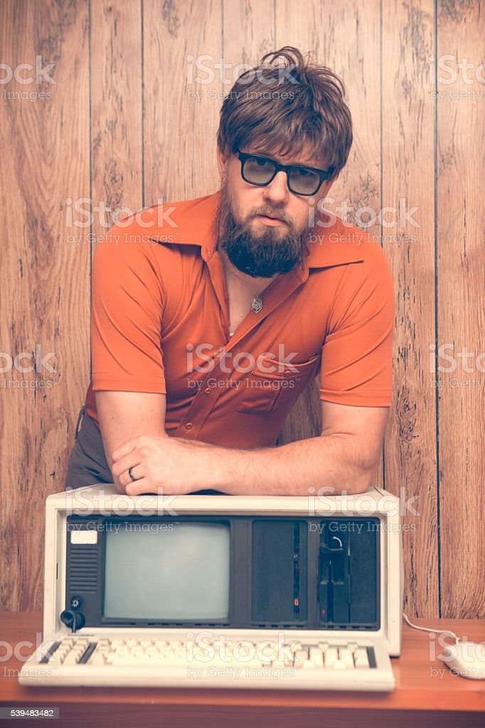 Vintage 1980's office worker with old computer stock photo