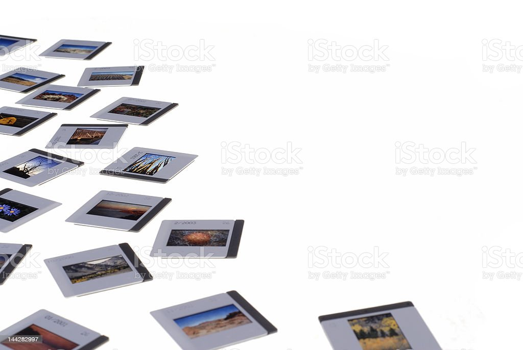 Vintage 35mm Slides Scattered on Light Box royalty-free stock photo
