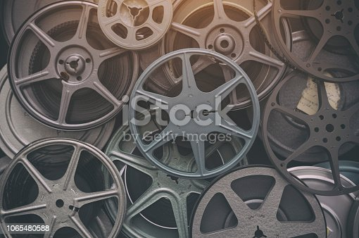 Large lot of vintage 8mm home movie film reels background.