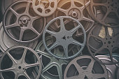 Large lot of vintage 8mm home movie film reels background.