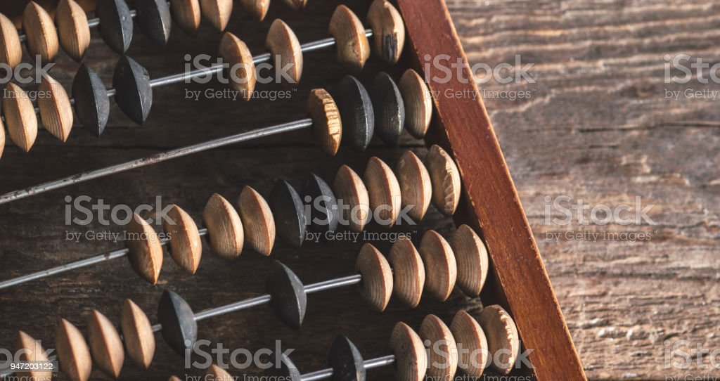 Vintage abacus on wood background stock photo