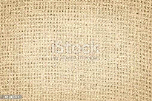 1044099896 istock photo Vintage abstract Hessian or sackcloth fabric or hemp sack texture background. Wallpaper of artistic wale linen canvas. 1131990417